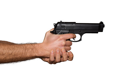 Automatic pistol handled with two hands photo