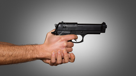 handled: Automatic pistol handled with two hands