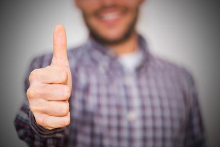 man gesturing OK sign on light background