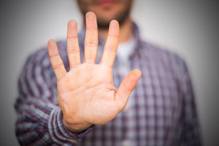 alt: Man gesturing alt or stop with hand