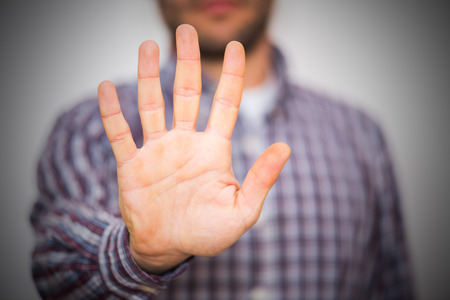 Man gesturing alt or stop with hand