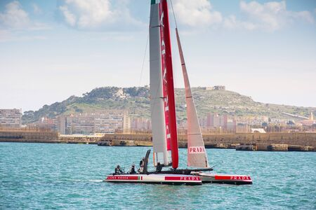 america's cup america: Cagliari - 10 March 2015 : Americas Cup Luna Rossa catamaran sails for training session in the Gulf of Cagliari,no special event, no credit or release needed. In the background Cagliari SantElia.