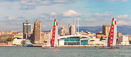 the americas: Cagliari - 10 March 2015 : Americas Cup Luna Rossa catamaran sails for training session in the Gulf of Cagliari,no special event, no credit or release needed. In the background the cruise terminal.