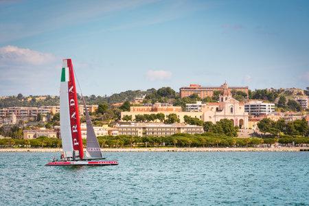 america's cup america: Cagliari - 10 March 2015 : Americas Cup Luna Rossa catamaran sails for training session in the Gulf of Cagliari,no special event, no credit or release needed. In the background the church of Bonaria.