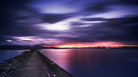 purposely: Very long exposure of cloudy sumset in the port - It was given an purposely dramatic effect and dark to make the photo more interesting