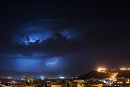 dark city: Storm cell over the city by night