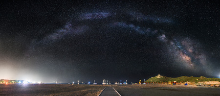 The arc of milky way over a beach - focus is on the tower and the noise is very low for this type of picture.