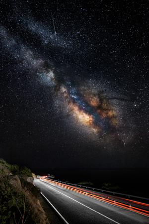 wide angle lens: Light trails on the road with the milky way galaxy on the sky (vertical) - all is in focus because its made with a wide angle lens, and the noise of the sky is very low for this type of pictures.