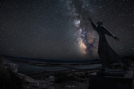 hypothetical: Milky way with statue of St. Francis that stretches to touch the stars - Cagliari city view of an hypothetical blackout - very low noise fot this type of picture Stock Photo