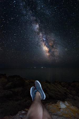 observer: Milky way viewed in first person of the observer with his legs - focus is on the stars the noise is not excessive for this type of picture