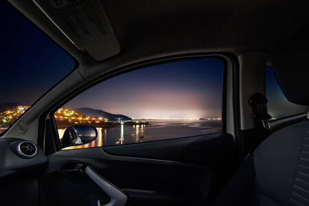 Coastal by night viewed from inside a car