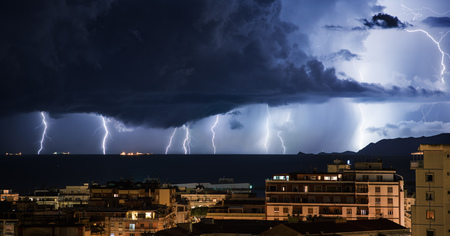 blue lightning: Lightning storm that hits the sea off the city