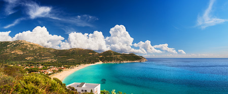 white sand beach: Paradise beach in a sunny day with astonishing clouds on the horizon