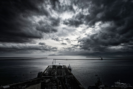 dramatic sky above the harbor Stockfoto