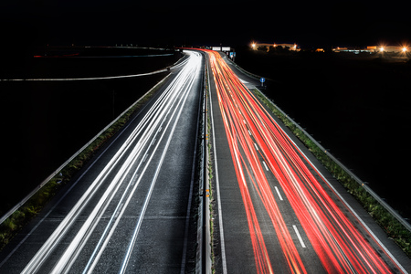 car lights: Highway by night with car lights trails Stock Photo