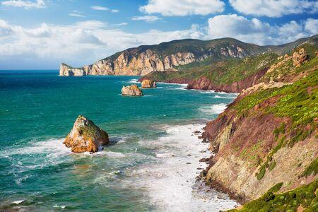 rough sea: Mediterranean coast with high cliffs and rough sea - horizontal version