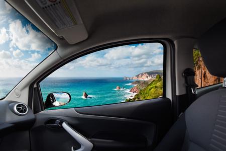 High cliffs coast viewed from inside a car