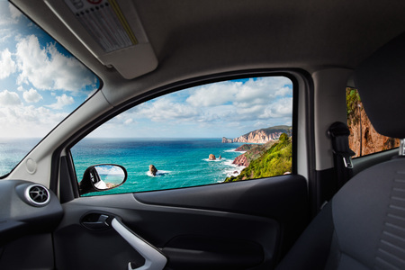 front of: High cliffs coast viewed from inside a car