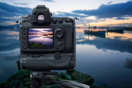 reflex camera: Reflex Camera on tripod near the lagoon, performing a long exposure at sunset