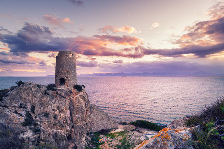 Ancient tower overlooking the sea at sunset
