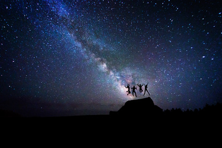 Peoples that jump happy under the milky way