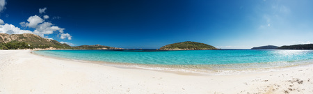 Panoramic view of a beautiful desert beach with white sand and clear sea. Sardinia Tuerredda beach Standard-Bild