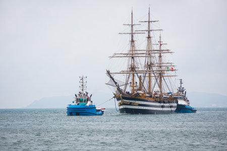 escorted: Cagliari, Italy: 30042016; Italian Navy Ship, Amerigo Vespucci is entering the port of Cagliari escorted by two tugboats