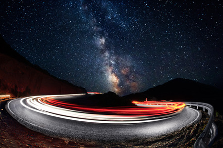 Stars and cars lights trails in the road Standard-Bild
