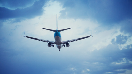 airplane landing: Passenger airplane landing - rear view Stock Photo