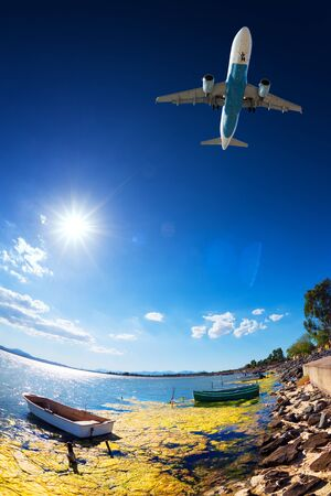 Jet plane flying over the pond to go to land Stock Photo