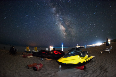personal watercraft: Watercraft on the beach at night under the stars