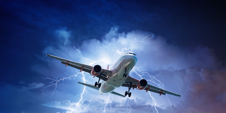air plane: Passenger aeroplane throught turbulent thunderstorm and lightnings Stock Photo