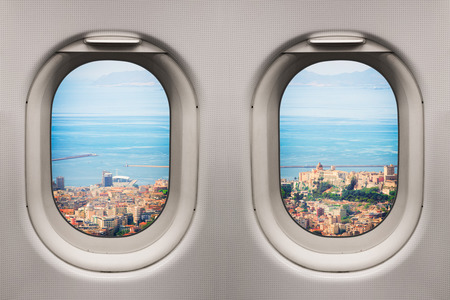 Ancient mediterranean city viewed from inside an airplane windows Stockfoto