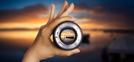 Photography view camera photographer lens lense through sunset sunrise cloud sky water lake concept - sunset at the pond with specular reflection Standard-Bild