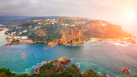 res: Coast with high cliff and turquoise sea at sunset