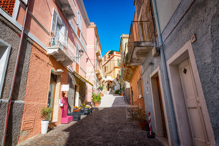 View of narrow street typical of Italian villages - View of beautiful Carloforte (Sardinia, Italy) narrow street.