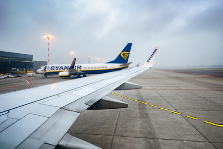 Bergamo, Italy 07102018 - Wing view, arrival at Bergamo Orio al Serio airport, whith a lot of Ryanair B737-800 airplanes.