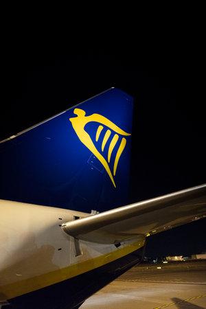 Bergamo, Italy 07/10/2018 -  Ryanair B737-800 tail close up at night Editorial