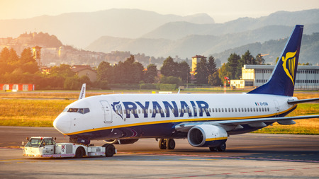 Bergamo, Italy 07102018 - Ryanair B737-800 pushing back to taxi for departure from Bergamo Orio Airport Editorial