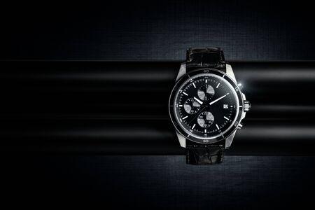 Nice luxury man's wrist watch on dark background. Stainless steel man's wrist watch with black leather strap. 写真素材
