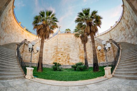 Internal staircase with garden of Bastione Saint Remy fortification, after the redevelopment, at sunrise  in Cagliari - Castello district.