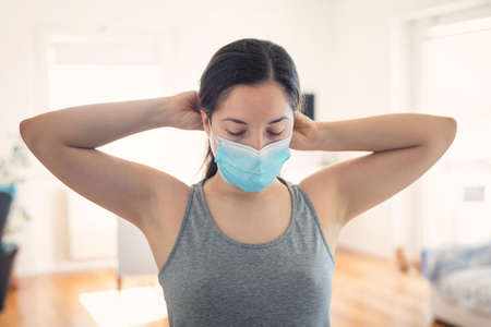 Woman wearing surgical mask for corona virus isolation.