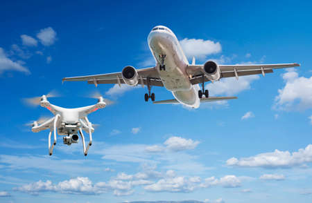 Drone flying near commercial airplane. Drone being hit by commercial airplane. Concept of aircraft accident.
