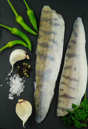 freshwater pike-perch fillet with garlic herbs and spices Standard-Bild