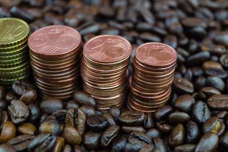 fair trade coffee price - roasted coffee beans and money
