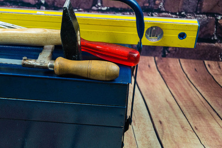 Different Tools like hammer, screw driver and spirit level on a tool box Stockfoto