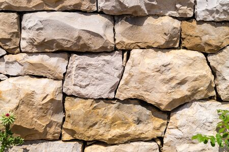 Wall of bricks or stones and fugues