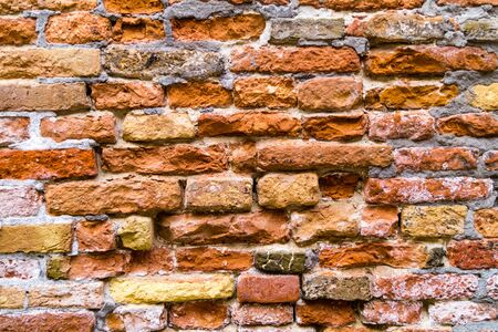 Wall of bricks or stones and fugues