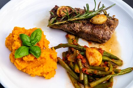 Rosemary lamb steaks with green beans and sweet potatoes