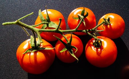 Round red tomato Solanum lycopersicum for a salad